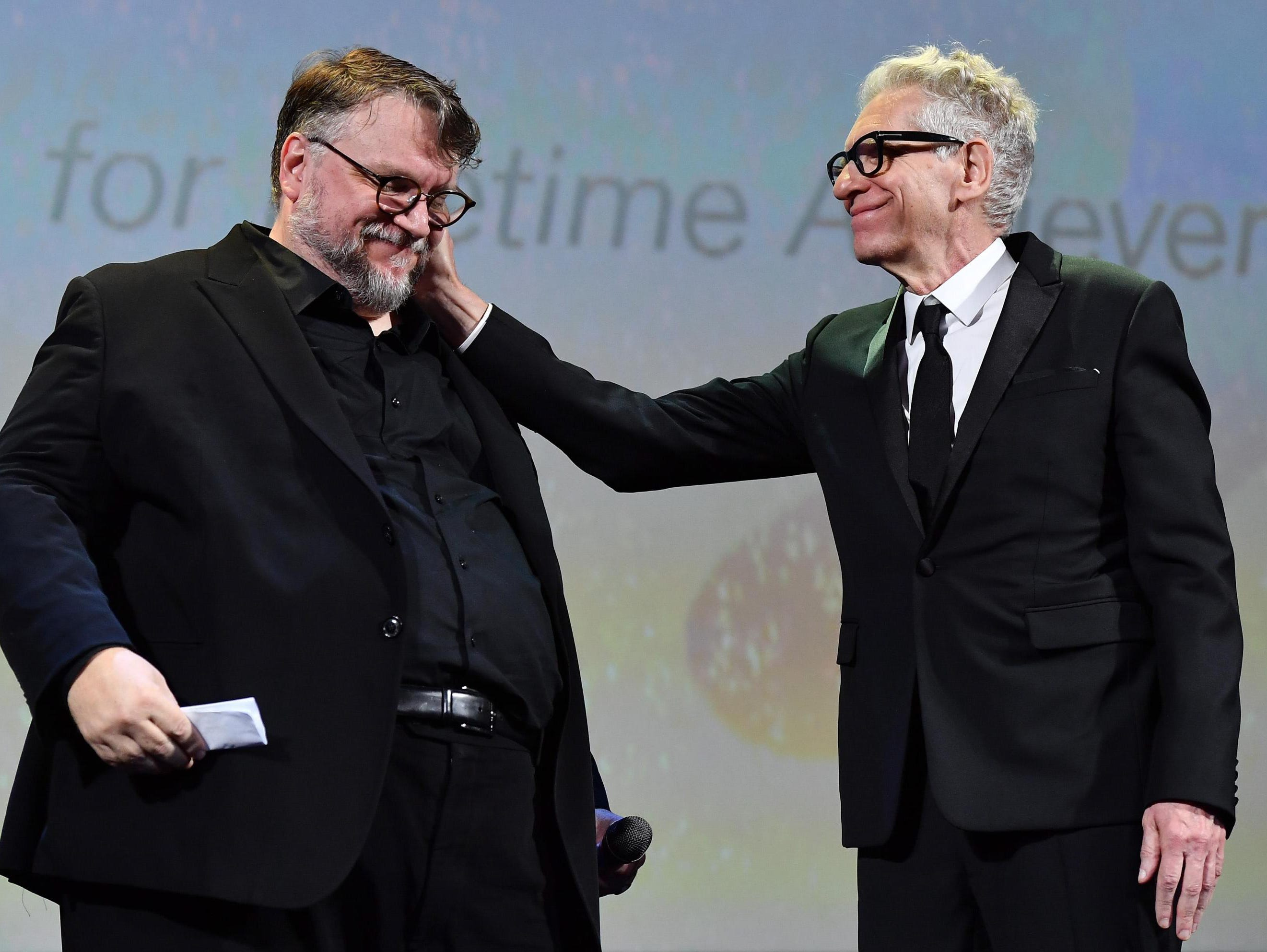 Filmmaker David Cronenberg and director Guillermo del Toro (L, president of the Venice Film Festival jury) after Cronenberg received the Golden Lion for Lifetime Achievement Award.