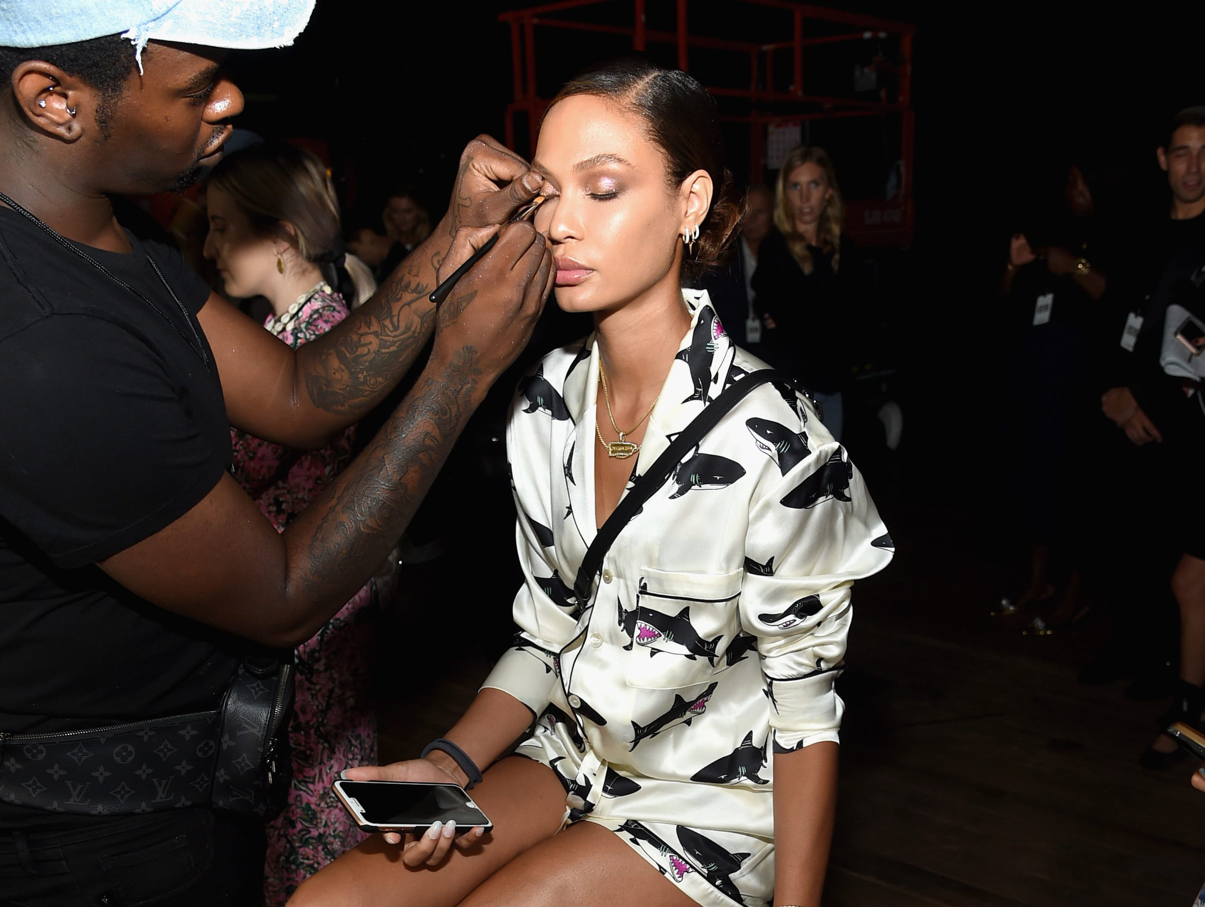 NEW YORK, NY - SEPTEMBER 05:  Joan Smalls prepares backstage at the Tom Ford fashion show during New York Fashion Week at Park Avenue Armory on September 5, 2018 in New York City.  (Photo by Jamie McCarthy/Getty Images) ORG XMIT: 775216224 ORIG FILE ID: 1027430866