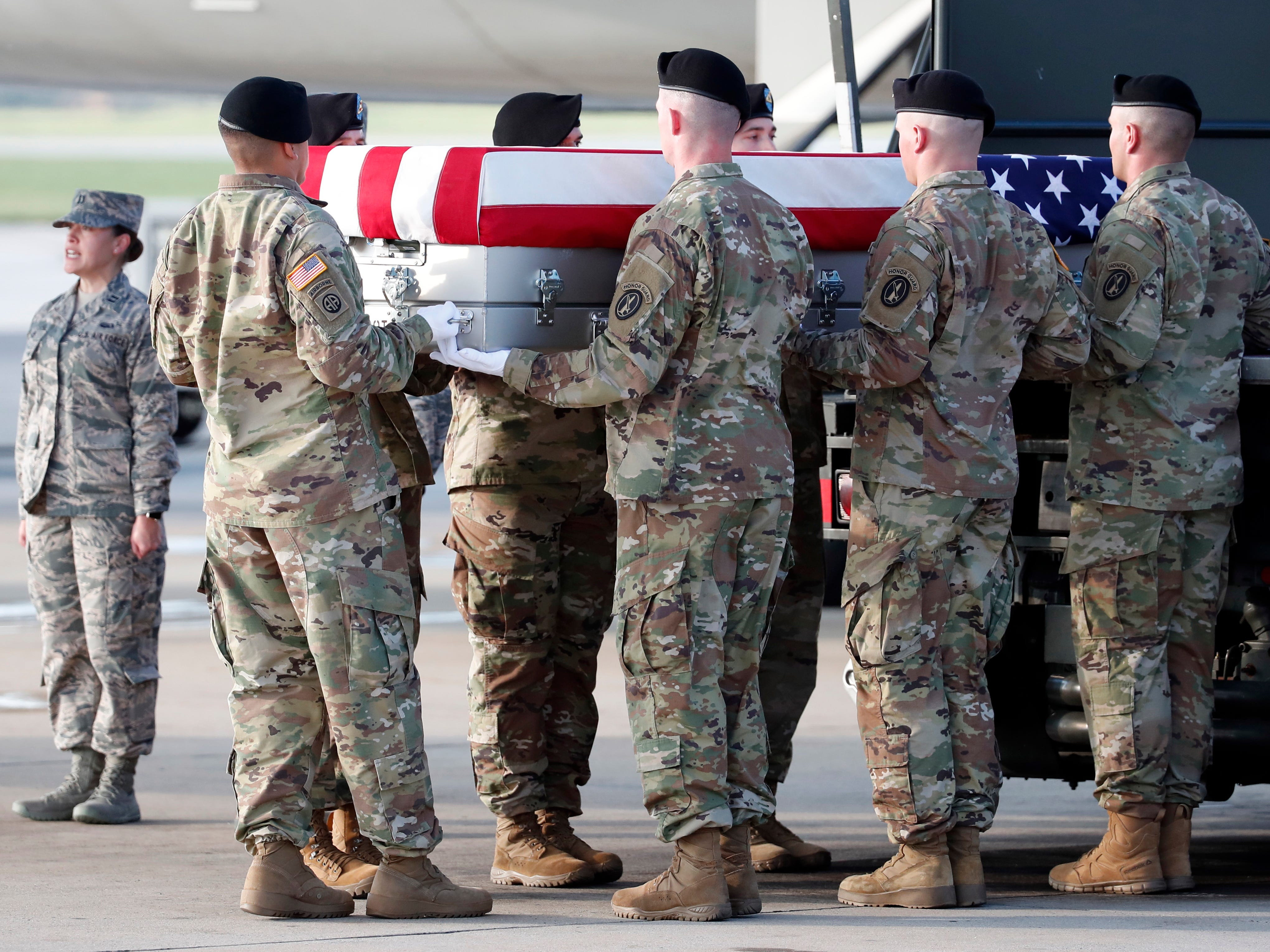 An Army carry team moves a transfer case containing the remains of U.S. Army Staff Sgt. Diobanjo S. San Agustin at Dover Air Force Base, Del.