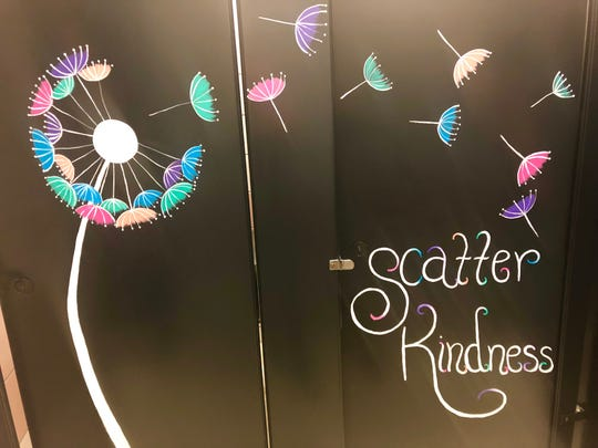 Parents at Mary Moore Elementary painted colorful works of joy in the school's bathrooms.