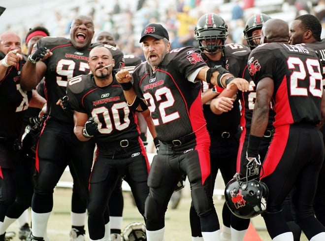 "Burt Reynolds, center, in a scene from the motion picture ""The Longest Yard."""