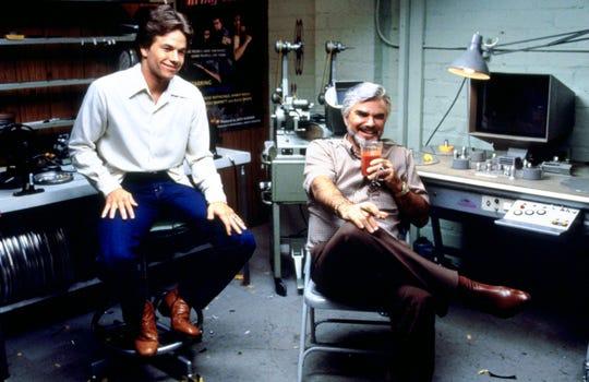 """Mark Wahlberg, left, played adult-film sensation Dirk Diggler and Burt Reynolds is porn director Jack Horner in """"Boogie Nights."""""""