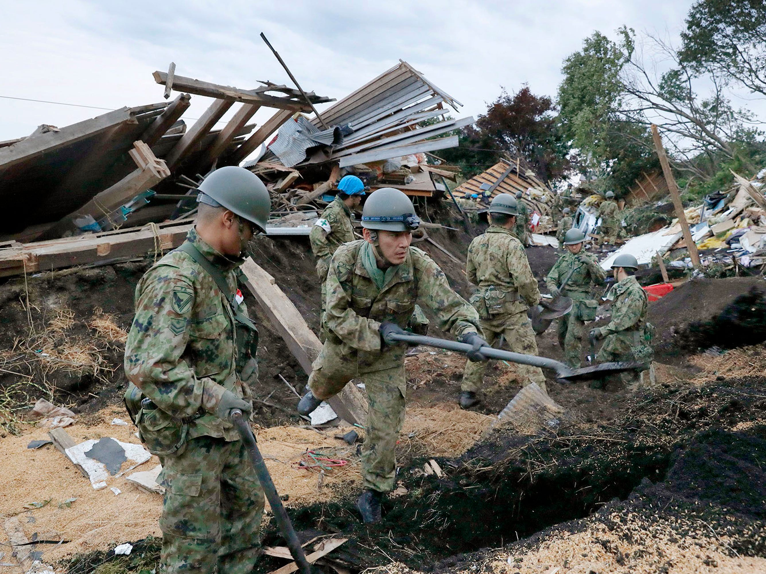 Japan Ground Self-Defense Force personnel search for missing persons at the site of a landslide triggered by a powerful earthquake in Atsuma, Hokkaido, northern Japan, Friday, Sept. 7, 2018.