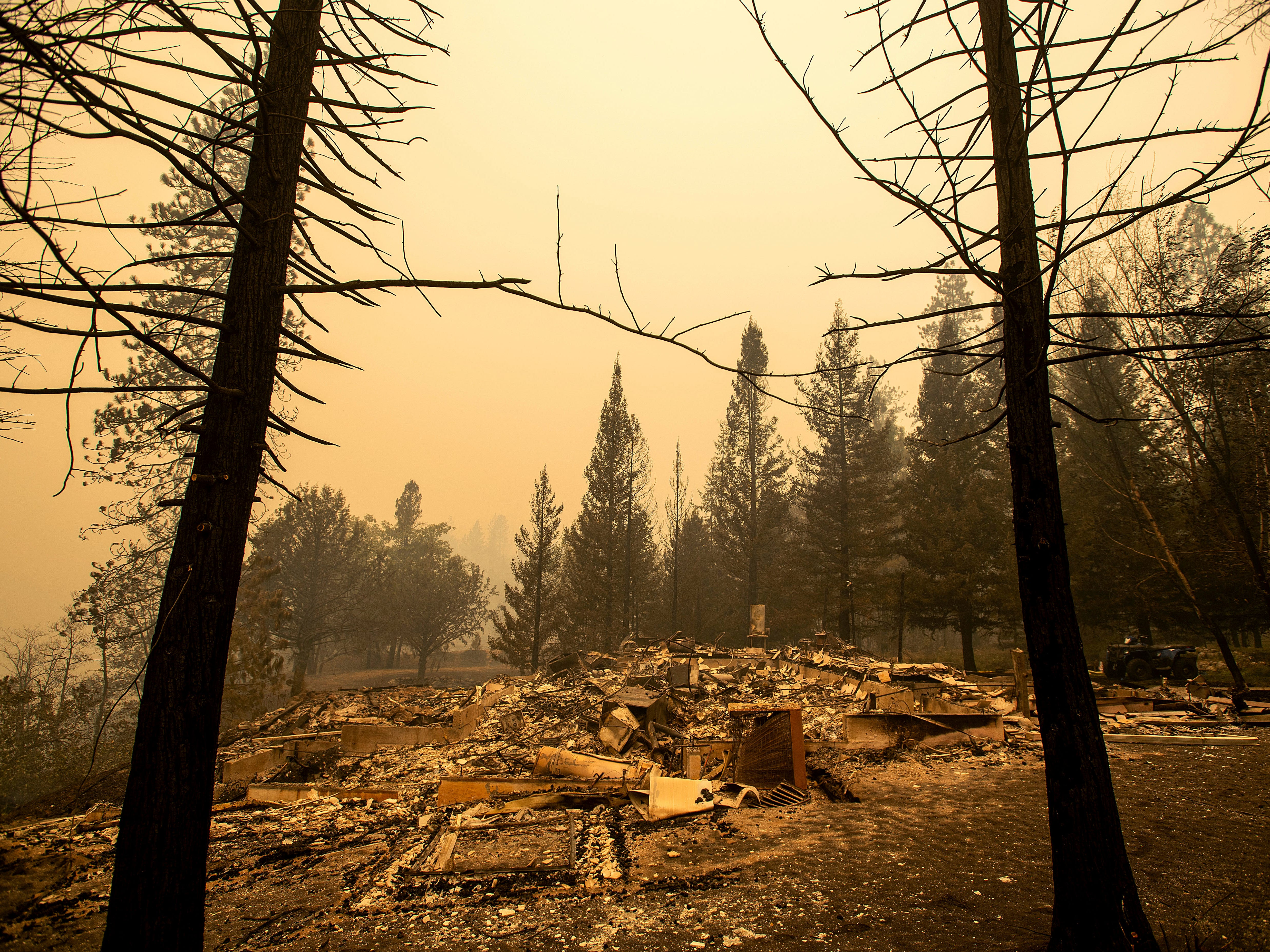 A home leveled by the Delta Fire rests in a clearing in Pollard Flat area of the Shasta-Trinity National Forest, Calif., on Thursday, Sept. 6, 2018. (AP Photo/Noah Berger) ORG XMIT: CANB108