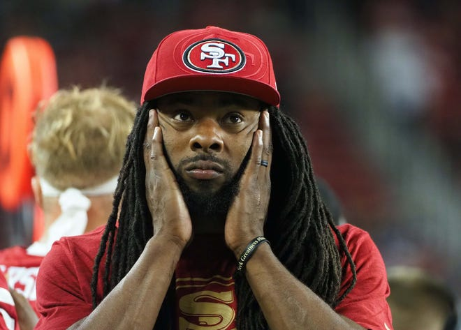 San Francisco 49ers defensive back Richard Sherman (25) holds his face on the sideline during the fourth quarter against the Dallas Cowboys 'at Levi's Stadium.