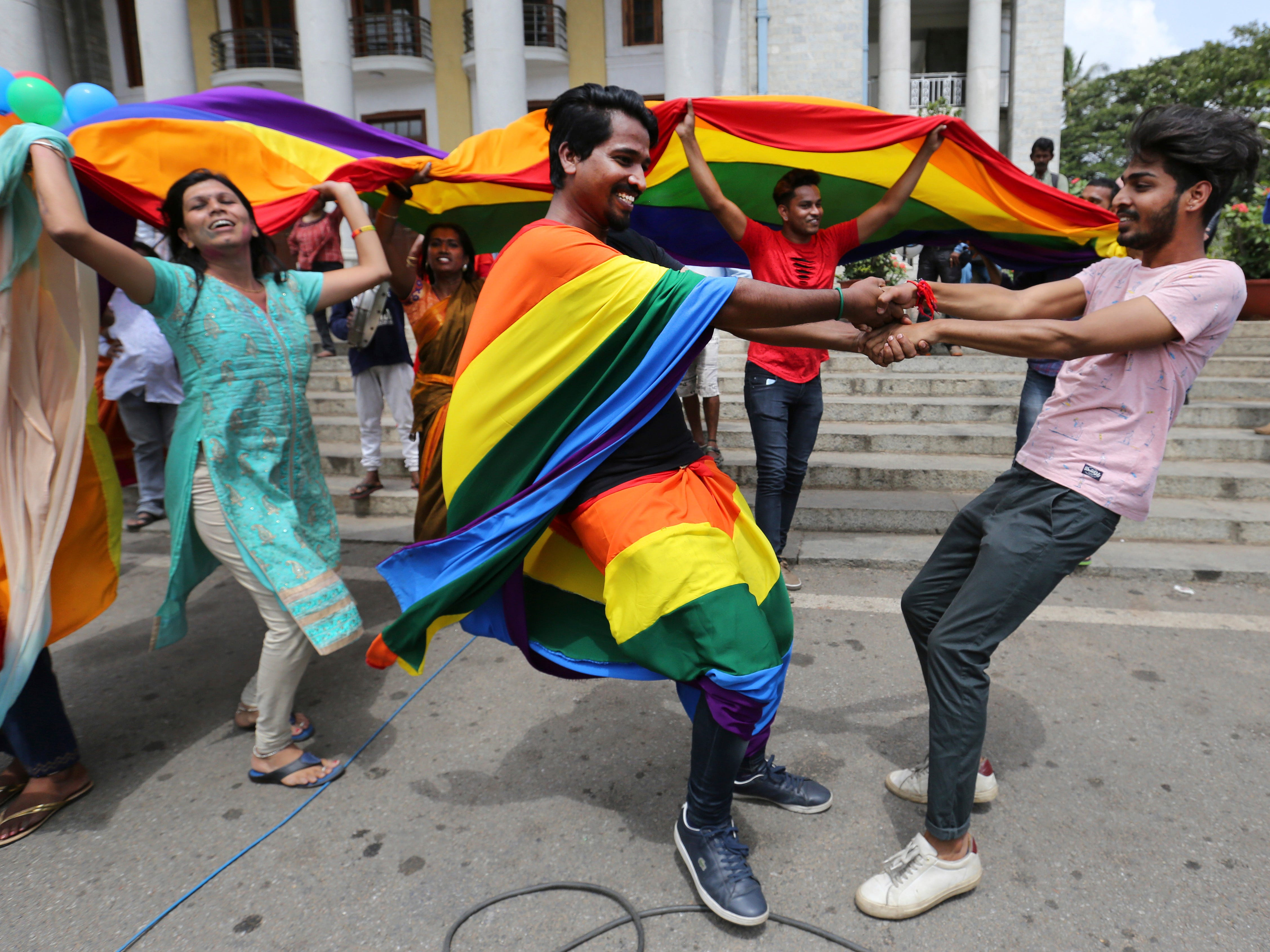 Supporters and members of the LGBT community dance to celebrate after the country's top court struck down a colonial-era law that made homosexual acts punishable by up to 10 years in prison, in Bangalore, India, Sept. 6, 2018.