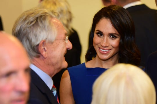Duchess Meghan of Sussex chats with guests during break at a charity gala performance in London on Sept. 6, 2018,  marking the centenary of the end of WWI.