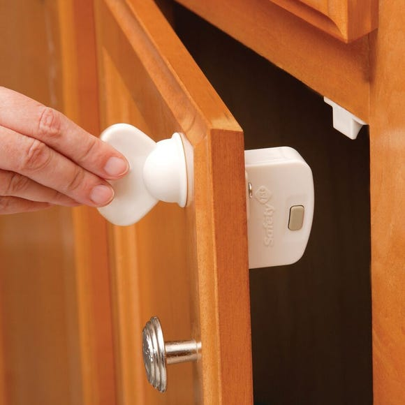 A Safety 1st magnet locking set for cabinet doors.