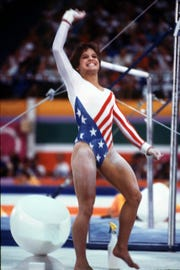 Mary Lou Retton, then 16, competes in the 1984 Olympics.
