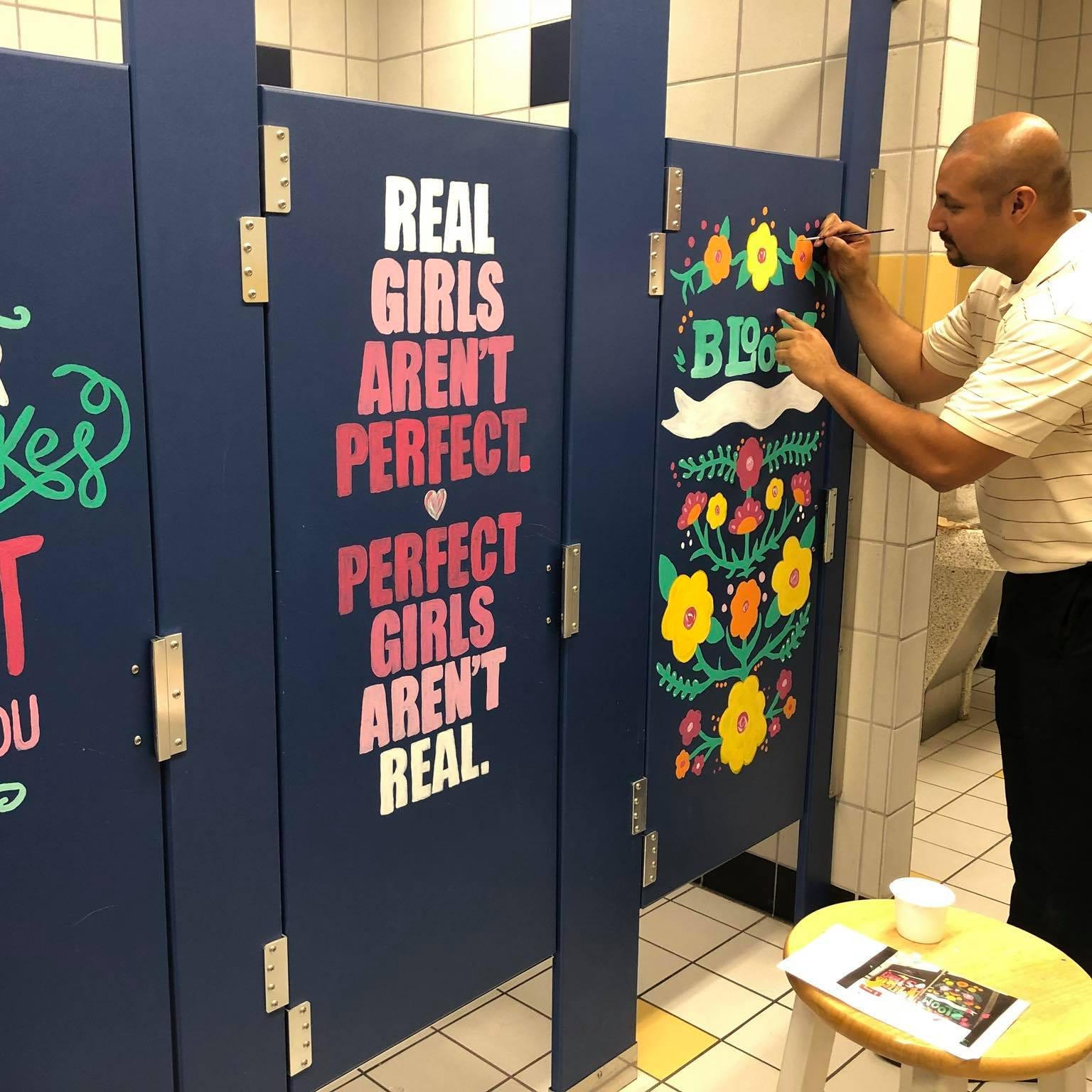 Teachers paint uplifting art on bathroom stalls for kids who need it most