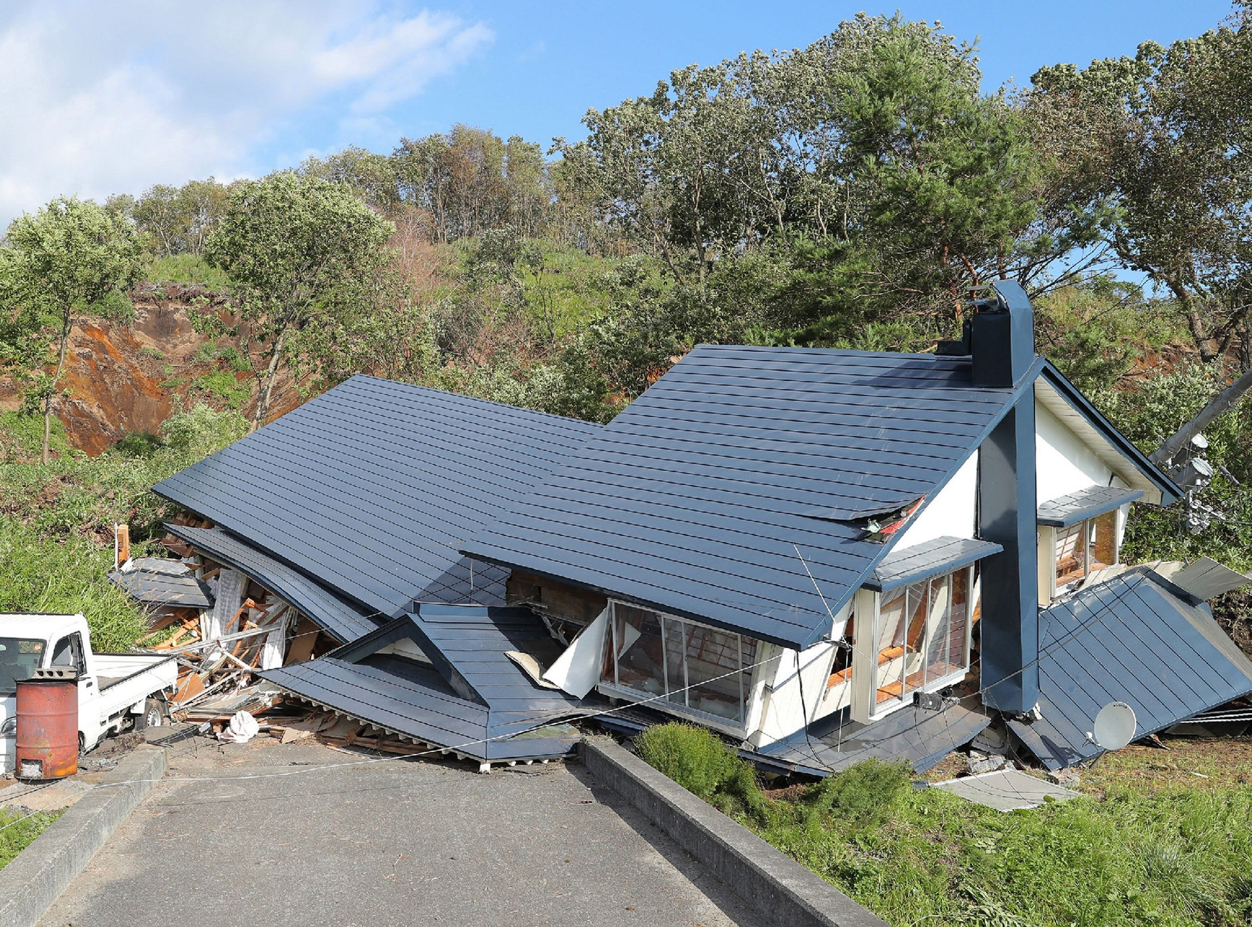 A house damaged by a landslide caused by an earthquake is seen in Atsuma in Hokkaido prefecture on Sept. 6, 2018.