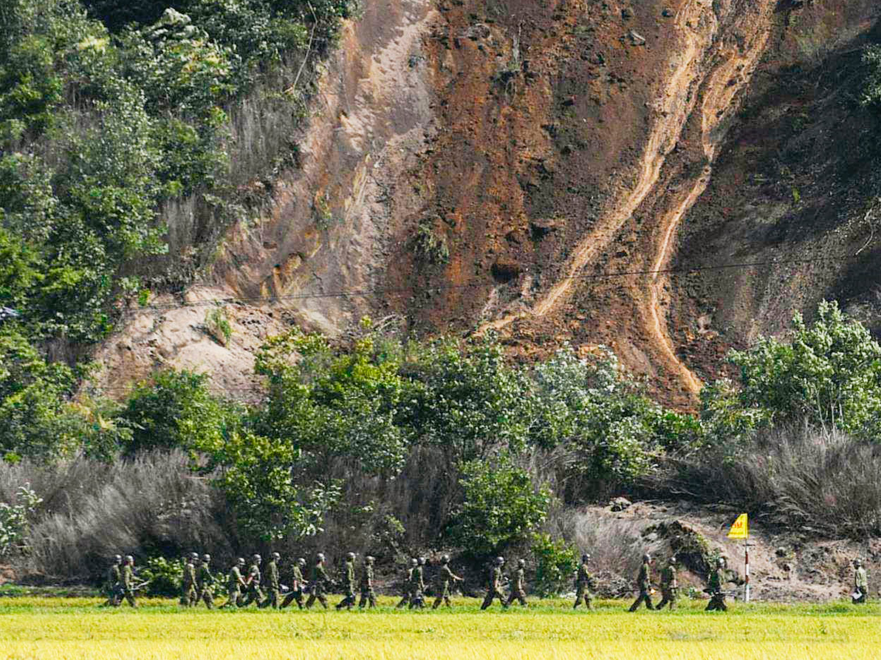 Japan Ground Self-Defense Force personnel head to the site of a landslide following a strong earthquake in Atsuma town, Hokkaido, northern Japan, Sept. 6, 2018.