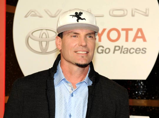Rapper Vanilla Ice, photographed in 2013, says he was aboard the Emirates airline flight that was quarantined Wednesday.