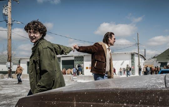 "Richie Merritt (White Boy Rick, left) takes the keys from Matthew McConaughey (Richard Wershe Sr.) in ""White Boy Rick."""
