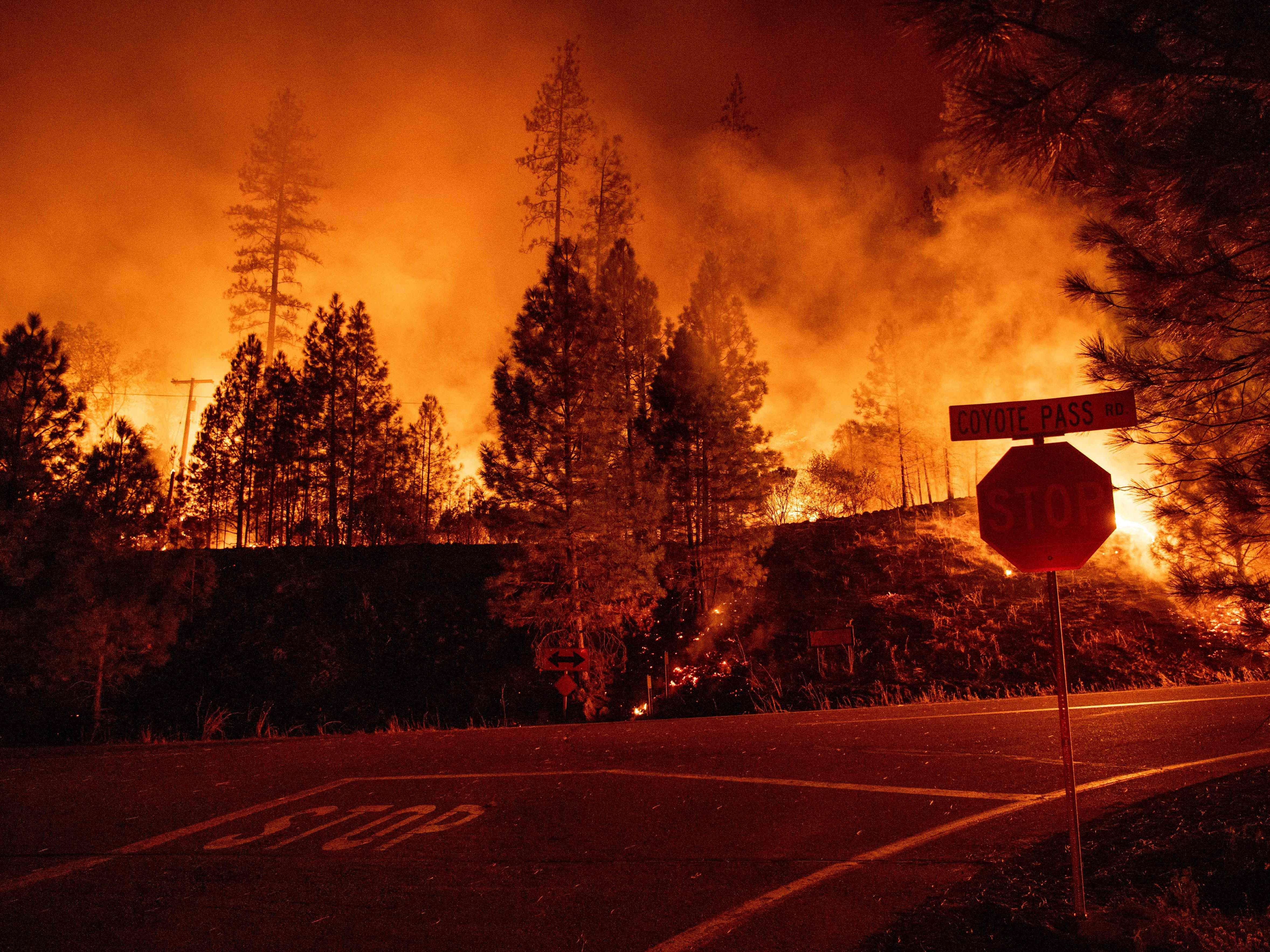Fire surrounds an intersection during the Delta Fire in near Delta, Calif. on Sept. 6, 2018.