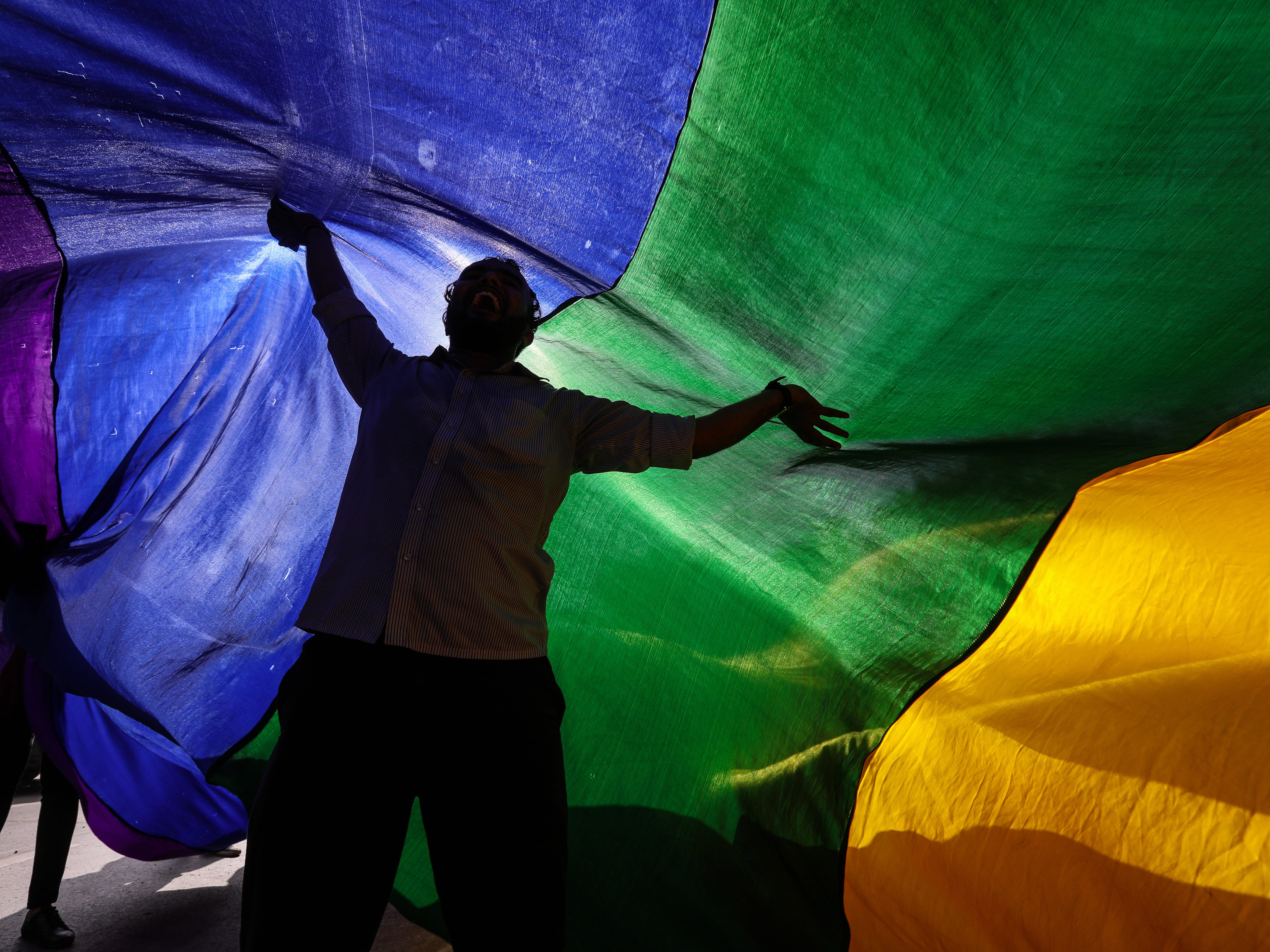 Gay rights activists celebrate during a rally after the hearing at the Supreme Court in Mumbai, India, Sept. 6, 2018.