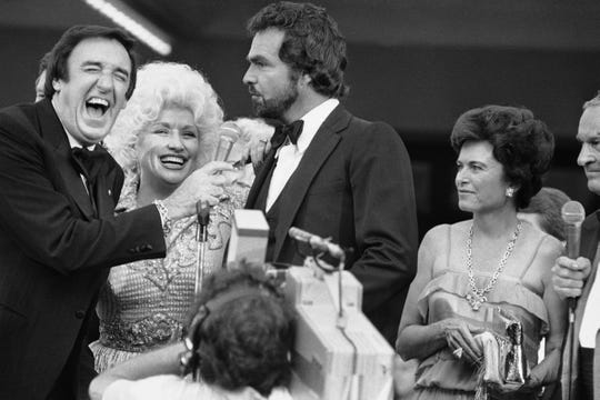 "Jim Nabors (far left), Dolly Parton and Burt Reynolds yuck it up at the 1982 premiere of ""The Best Little Whorehouse in Texas."""