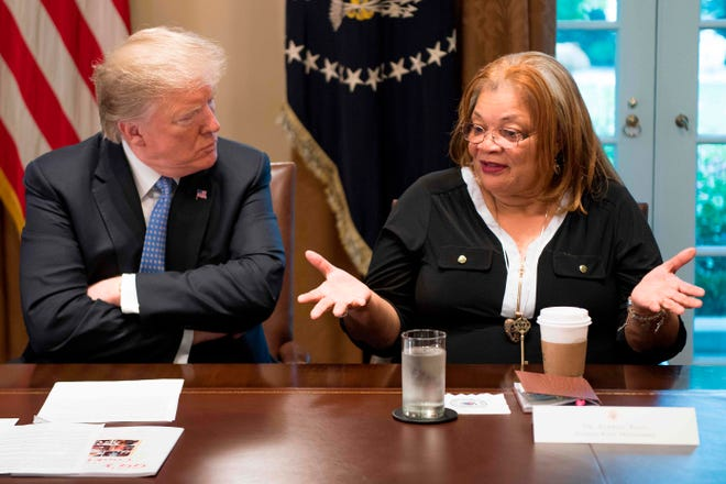 President Donald Trump listens to Alveda King, niece of Martin Luther King Jr., during a meeting with inner city pastors at the White House Aug. 1, 2018.