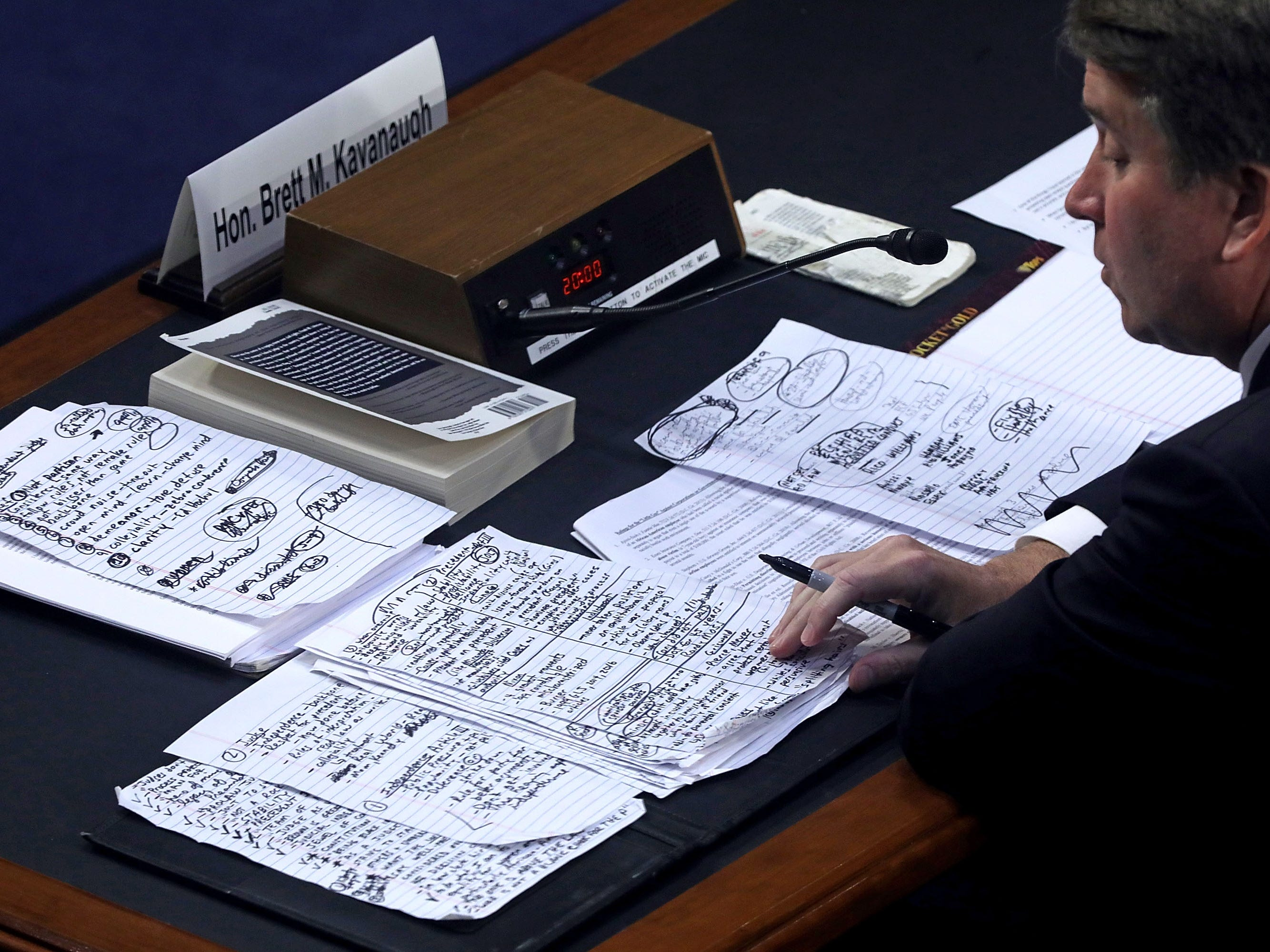Supreme Court nominee Brett Kavanaugh looks over his notes while testifying before the Senate Judiciary Committee on the third day of his confirmation hearing in Washington, Sept. 6, 2018.