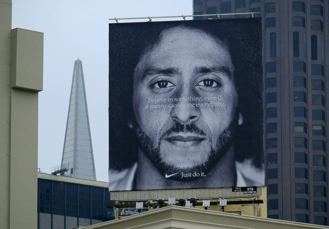 A large billboard stands on top of a Nike store at Union Square in San Francisco showing former 49ers quarterback Colin Kaepernick.