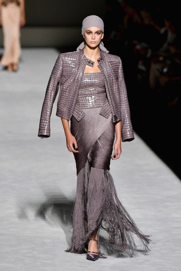 Kaia Gerber rocked the runway in a head wrap paired with a lilac gown and crocodile jacket at the Tom Ford fashion show during New York Fashion Week.