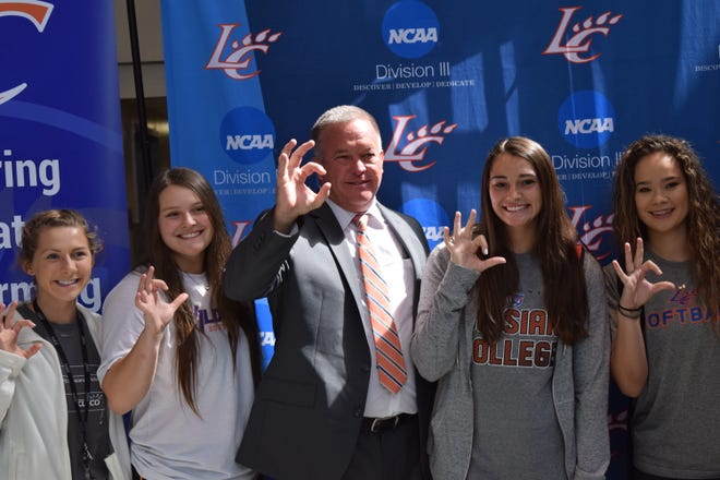 Barry Roberts (center) was announced as they new head coach of the Louisiana College women's softball team Friday.