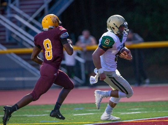 Brick Memorial senior quarterback Tyler Sindel, shown scoring a touchdown against Central Regional, is the Week 0 Asbury Park Press Offensive Player of the Week.