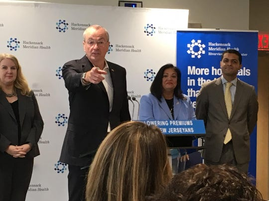 Gov. Phil Murphy announces lower premium rates for 2019.