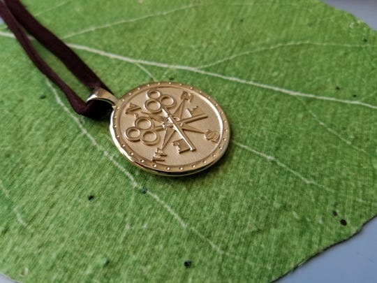 Jane Winchester's Gold Coin Jewelry inspires the wearer with positive messages.