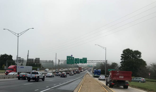 Eastbound traffic slowly crosses Bowen Bridge during a foggy rush hour Friday morning.
