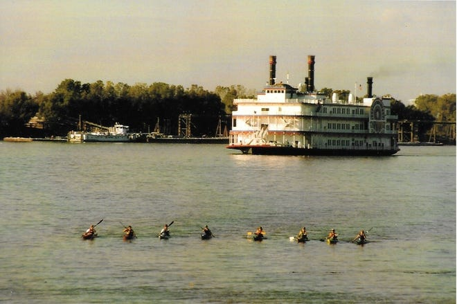 Kayakers from Brevard College assembled in front of a paddle wheeler on the Mississippi River in 1997. The group paddled from Rosman, N.C., to the Gulf of Mexico.