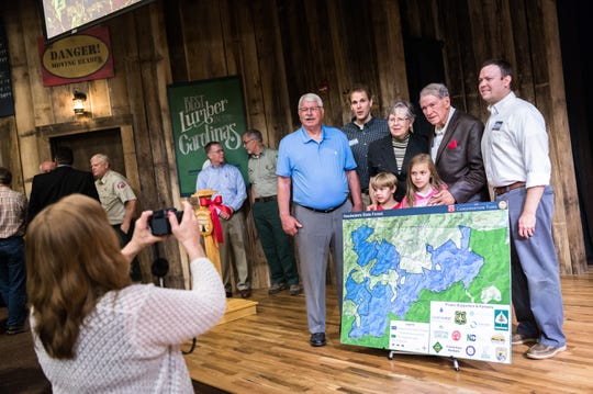 Charles Taylor, former NC congressman, second from right, poses for a photo with his family and with N.S. Agriculture Secretary Steve Troxler, far left, at the ribbon-cutting ceremony for the new Headwaters State Forest in Transylvania County, Sept. 6, 2018. Taylor sold some of his private land to help create the forest.