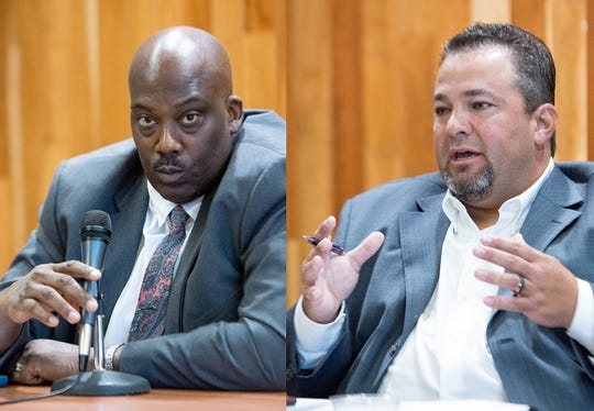 Buncombe County sheriff candidates Quentin Miller, left and Shad Higgins, right, debate Friday morning.