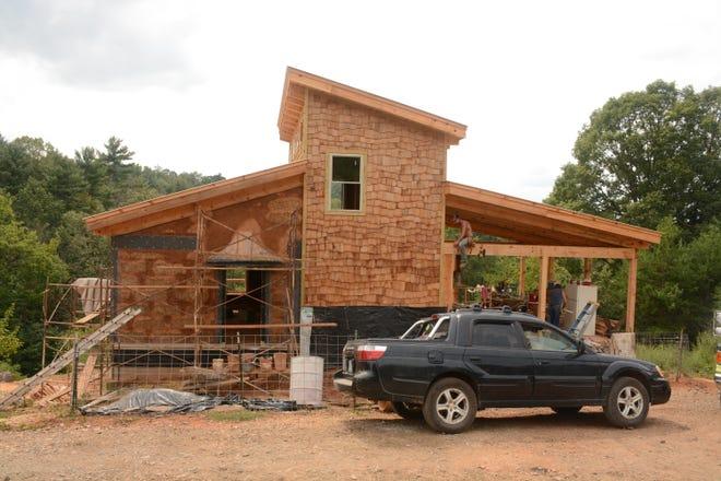 "Cedar shakes in a ""wave design"" serve as an external design feature on Elizabeth Pantzer's new home."
