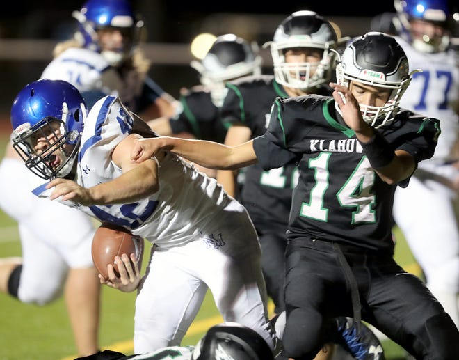 North Mason's Reese Smelcer scored the winning touchdown in overtime in the Bulldogs' 20-14 win over Klahowya at Silverdale Stadium.