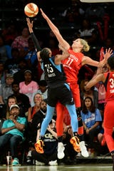 Mystics star Elena Delle Donne, right, stands in the way of the Storm in the WNBA finals.
