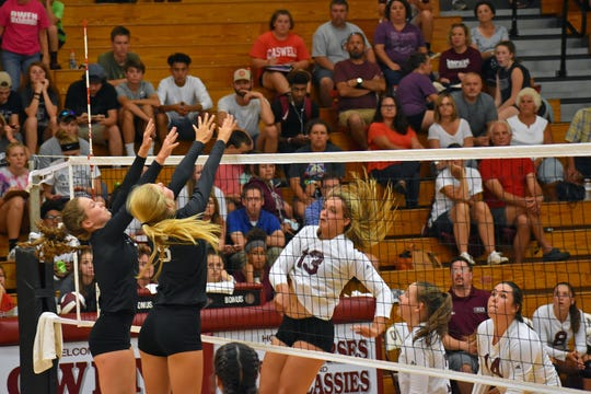 Senior Chesney Gardner follows through on a kill at home against North Buncombe.