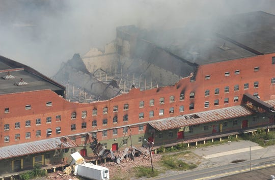 An aerial photo of the Beacon Manufacturing plant shows the building burning on Sept. 3, 2003.