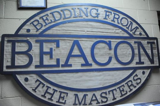 One of three signs recovered from Beacon Manufacturing after the 2003 fire hangs in the Swannanoa Fire Department.