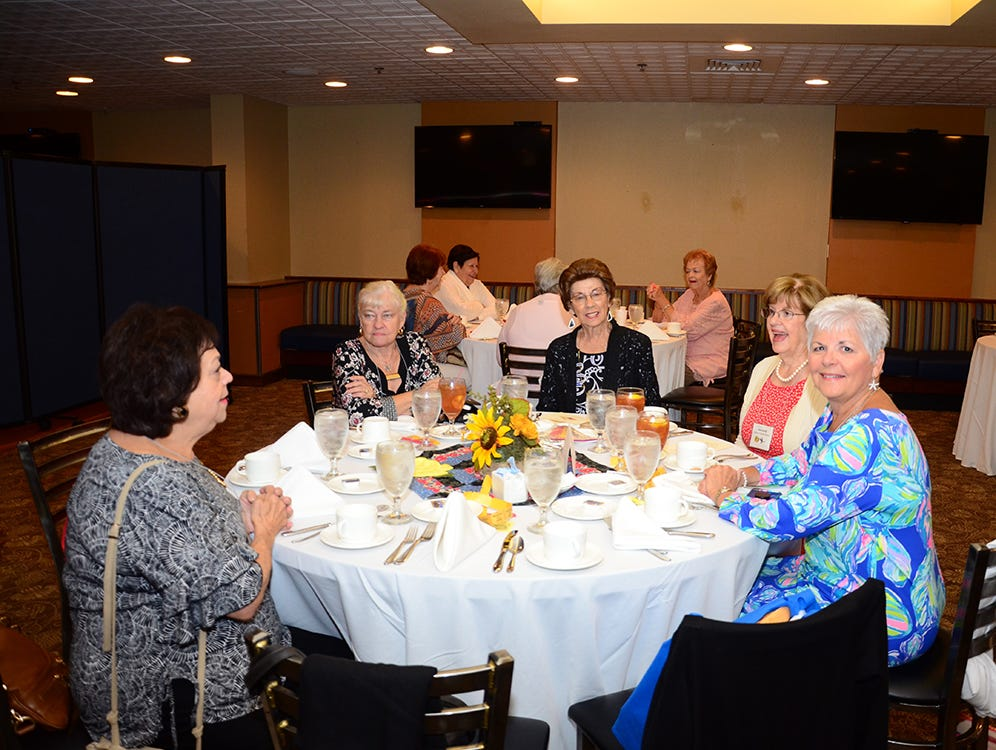Beta Sigma Phi Sorority gather at The Tides Restaurant at Patrick Air Force Base Saturday.