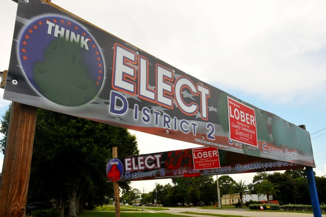 With the help of some spray paint, some of former Democratic District 2 Brevard County Commission candidate Jack Smink's campaign signs, like this one in Rockledge, have been converted to campaign signs supporting republican   Bryan Lober signs. Smink gave Lober permission to make the sign  transformation.