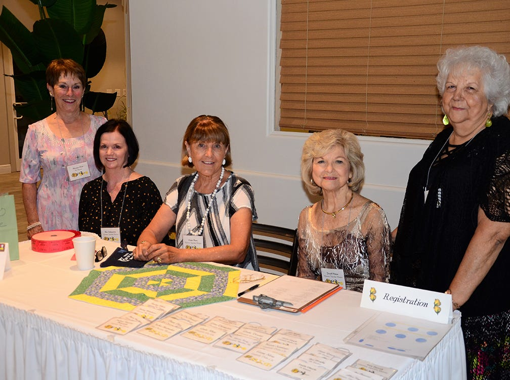 Members of Beta Sigma Phi Sorority, Florence Short, Dee Siebeneichen, Linda Paula, Jewel Patton and Irene Jarvis welcome their sisters for the Beginning Day Luncheon - A Quilt of Friendship year which was held at The Tides Restaurant at Patrick Air Force Base.