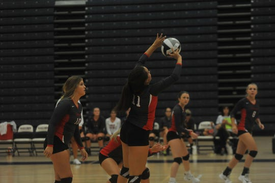 Shelby's Sydney Seibert sets a teammate.