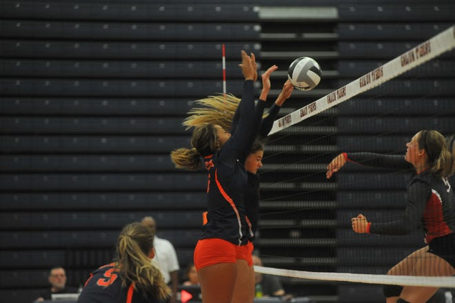 Galion's Samantha Comer and Brooklyn Cosey block a hit from Shelby's CC Gurney.