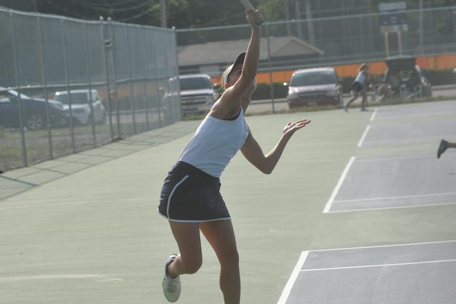 Katherine Talbott serves against Pleasant.