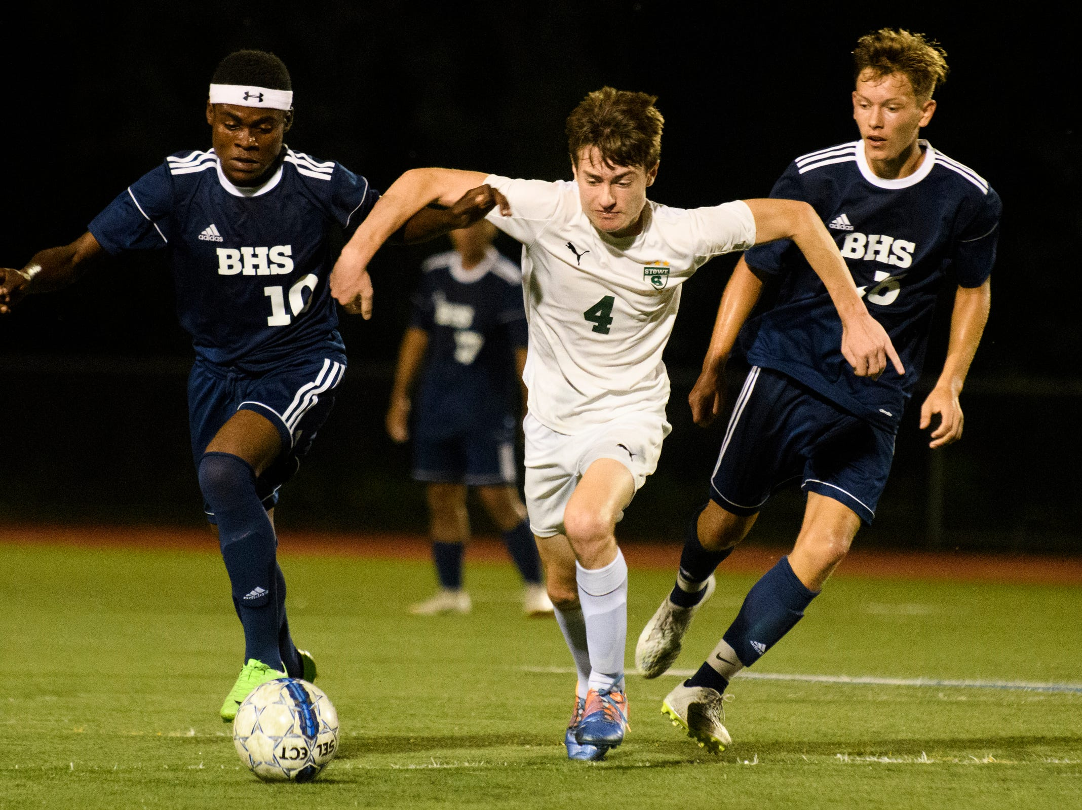 Stowe's Alex Reichelt (4) battles for the ball with Burlington's Will Badibanga (10) during the boys soccer game between Stowe and Burlington at Buck Hard field on Wednesday night September 5, 2018 in Burlington.