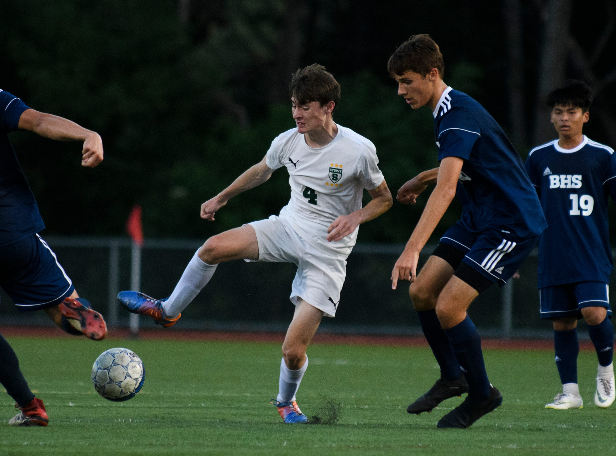 Stowe's Alex Reichelt (4) plays the ball during the boys soccer game between Stowe and Burlington at Buck Hard field on Wednesday night September 5, 2018 in Burlington.
