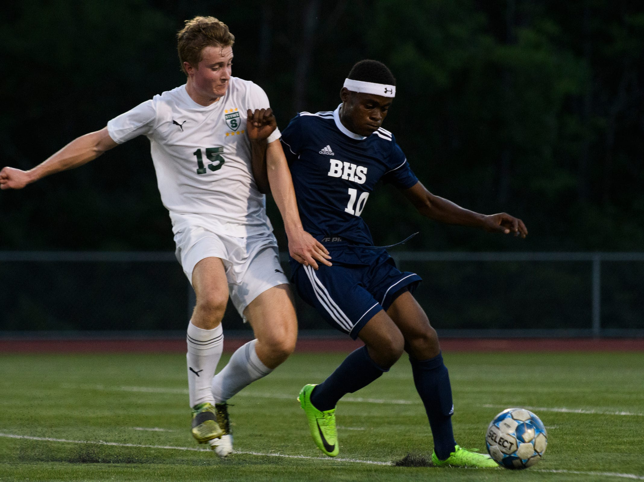 Stowe's Jace Boerger (15) battles for the ball with Burlington's Will Badibanga (10) during the boys soccer game between Stowe and Burlington at Buck Hard field on Wednesday night September 5, 2018 in Burlington.