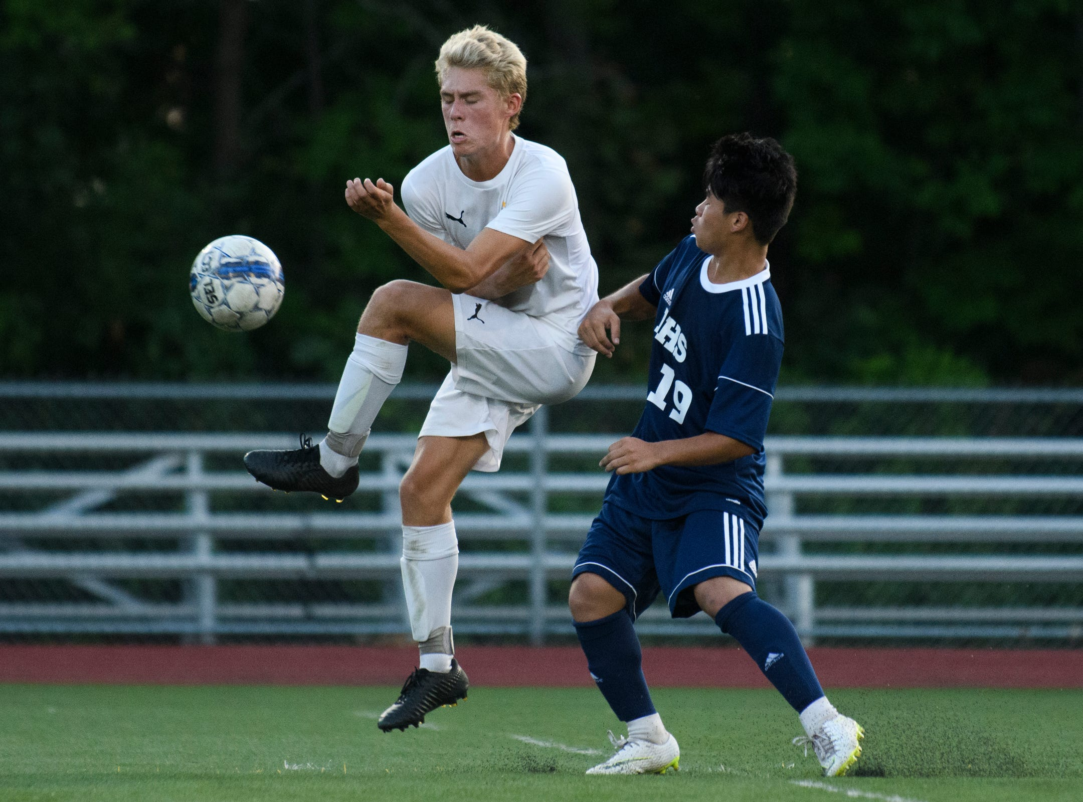 Stowe's Jack Seivwright (10) and Burlington's Roman Magar (19) battle for the ball during the boys soccer game between Stowe and Burlington at Buck Hard field on Wednesday night September 5, 2018 in Burlington.