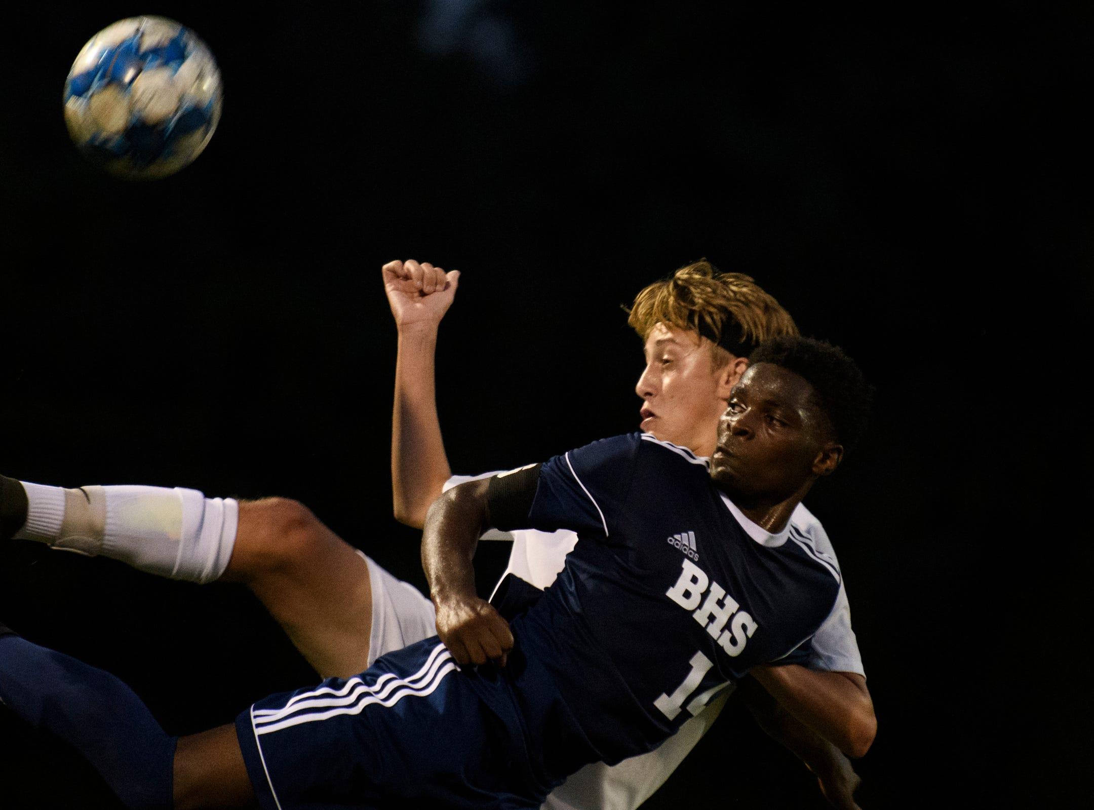 Burlington's Hussein Mubarak (14) and Stowe's Jack Seivwrigth (10) battles for the ball during the boys soccer game between Stowe and Burlington at Buck Hard field on Wednesday night September 5, 2018 in Burlington.